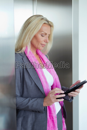 businesswoman using tablet in lobby