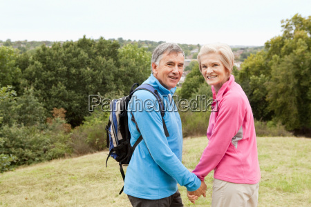 mature couple hiking looking back