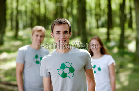 three young persons standing in nature