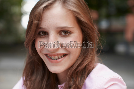 girl with braces smiling into camera