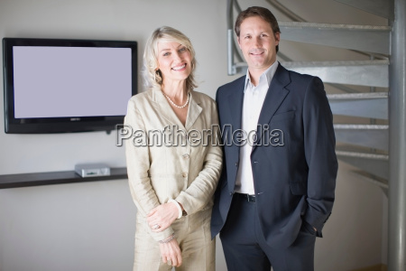 business people smiling in office