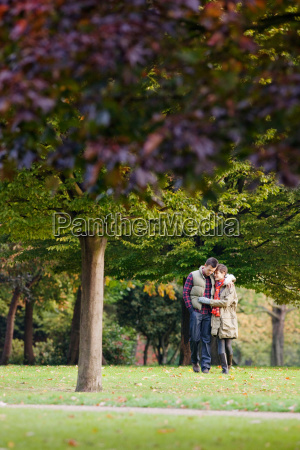 young couple walking through the park