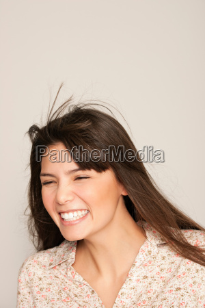 portrait of young woman laughing