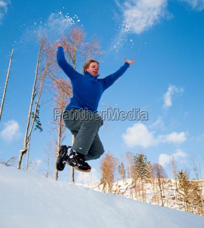 man jumping into snow