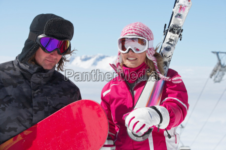 skiers carrying equipment outdoors
