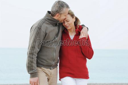 couple hugging on beach