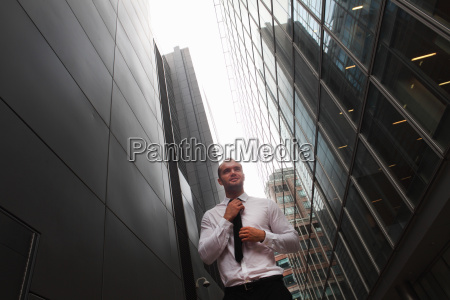 businessman walking on city street