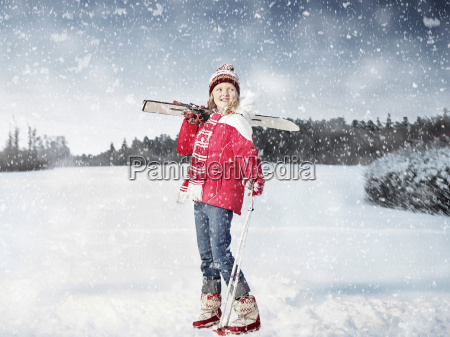 girl carrying cross country skis in