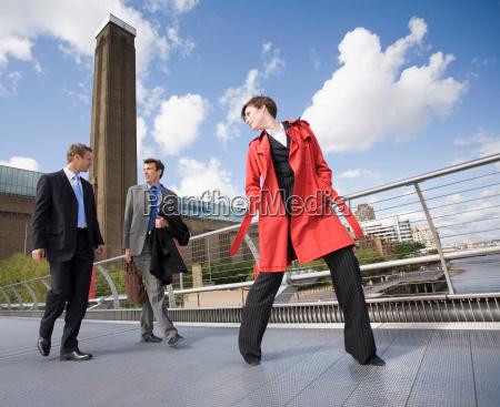 business people talking on walkway