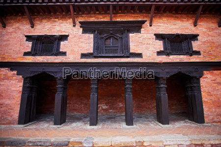 wooden architecture on brick house