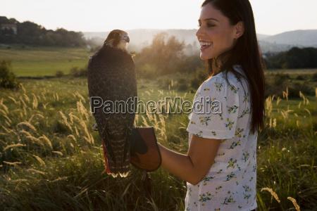 woman holding bird