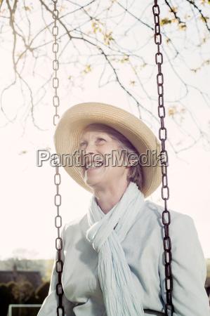happy senior woman with straw hat