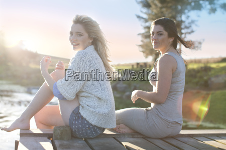 two female friends sitting on breezy