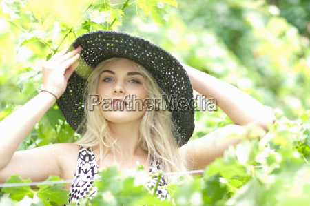 woman wearing sun hat in tall