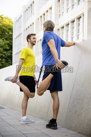 two men stretching hamstrings