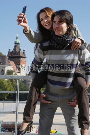 couple taking a picture outdoors with