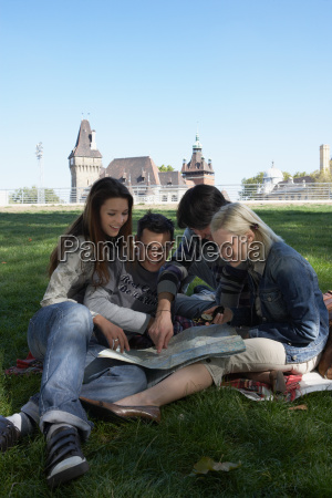 four people in a park looking