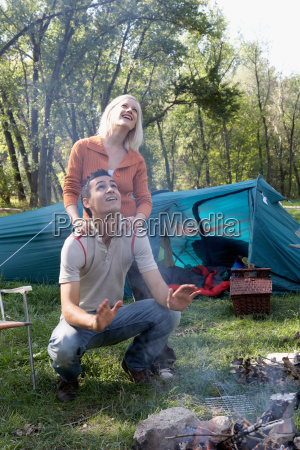 couple at campsite looking up at