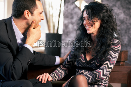 man in conversation with woman