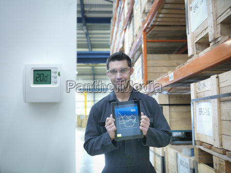 proud factory worker showing energy saving