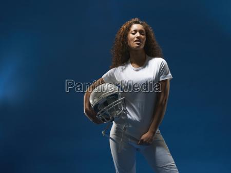 portrait of female american footballer holding