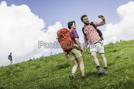 young adults hiking tyrol austria