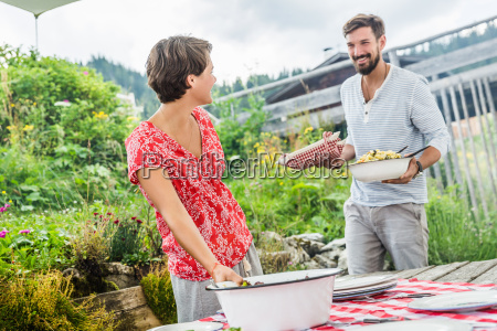 young couple preparing picnic lunch tyrol