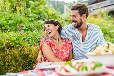 young couple having picnic lunch tyrol