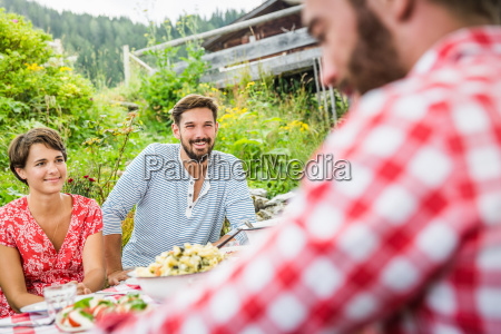 group of friends having picnic lunch