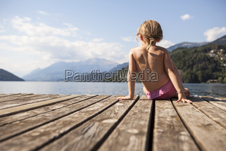 rear view of girl sitting on
