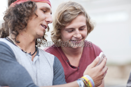 two young male adult friends looking