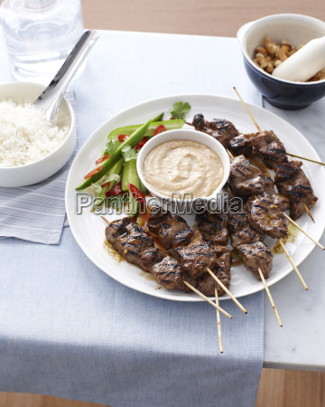 still life of beef skewers and