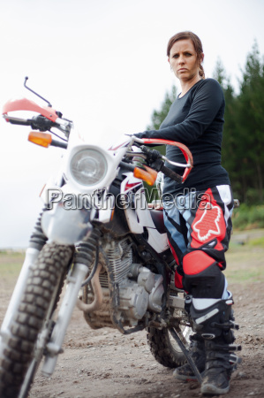 portrait of young adult female motorcyclist