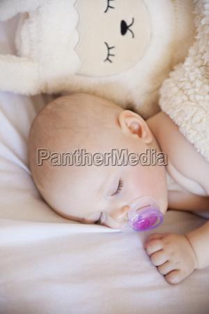 baby girl sleeping in crib with