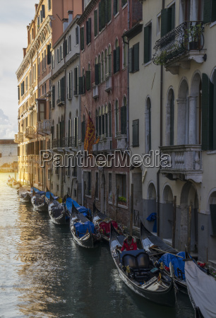a row of gondolas and the