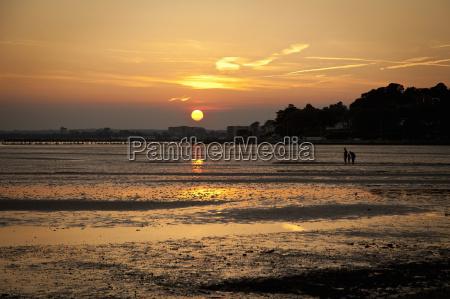 sunset at beach bournemouth dorset uk