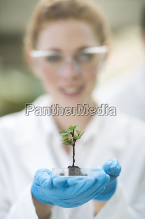 portrait of female scientist holding up