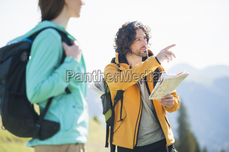 mid adult man looking at map