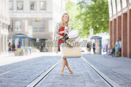 young woman carrying shopping bags on