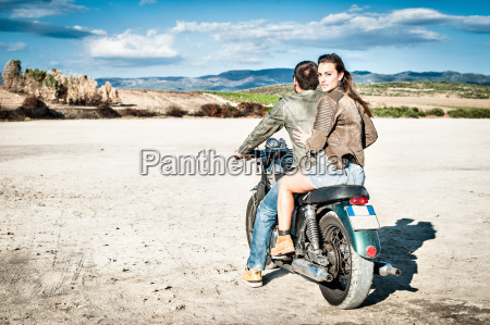 rear view of young couple riding