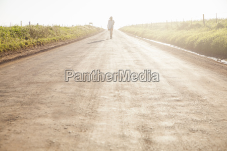 mid adult woman walking on country