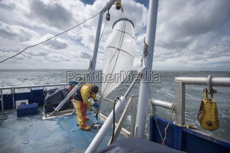 scientist preparing plankton net on research