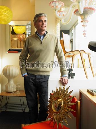 mature man standing in furniture shop
