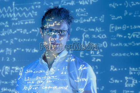 portrait of scientist with projected mathematical