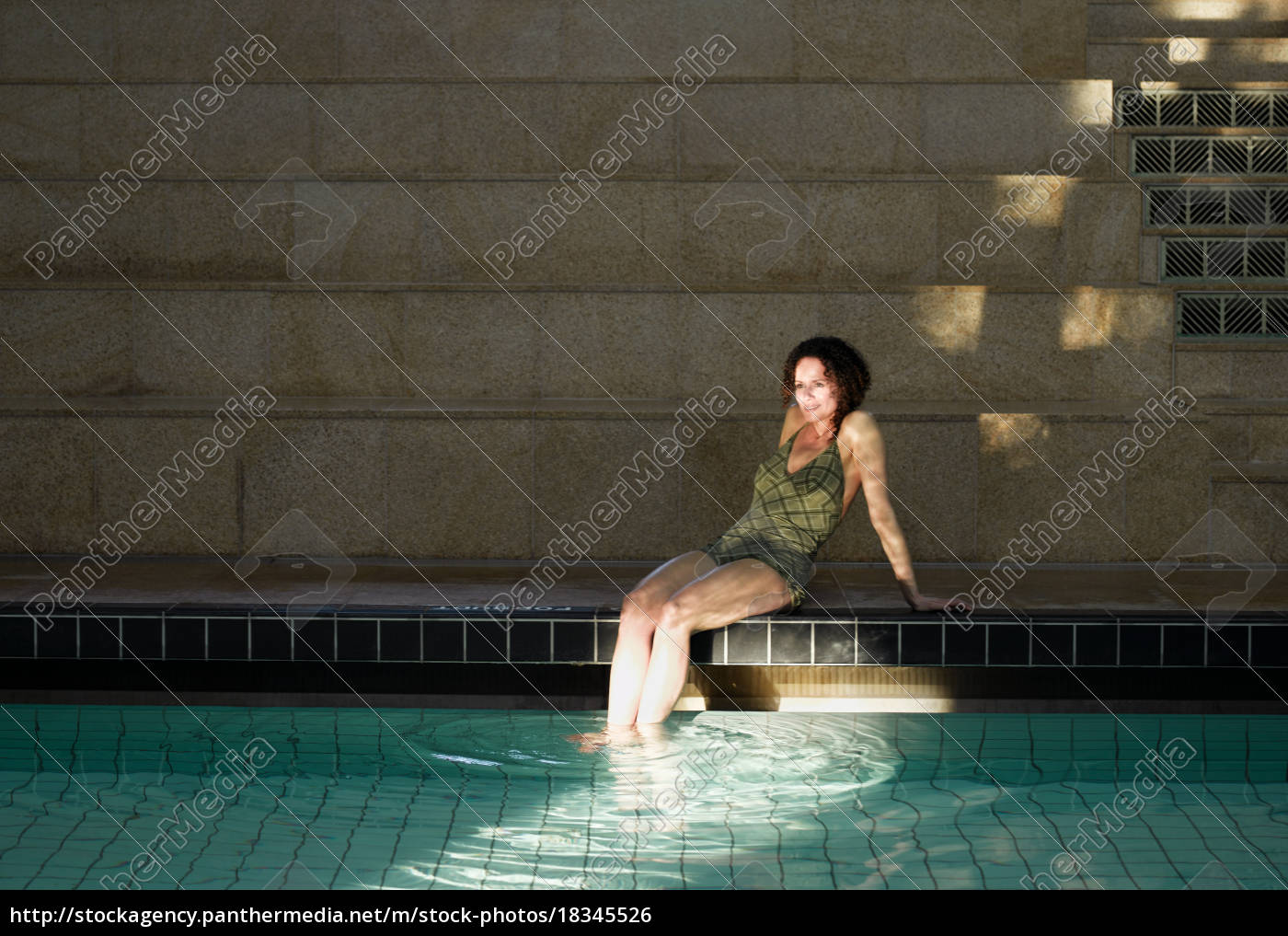 woman, sitting, by, swimming, pool - 18345526