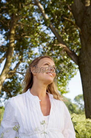 portrait of woman under trees