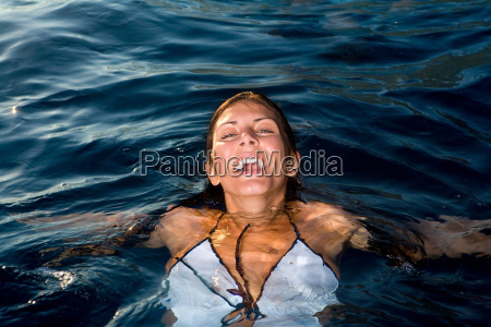 young woman in water smiling