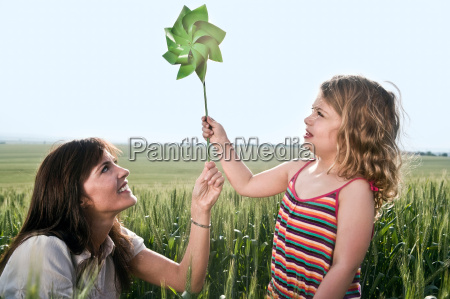 woman and child holding toy windmill