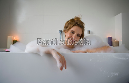 woman smiling in bathtub