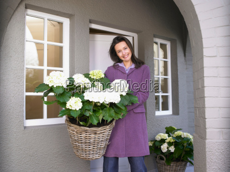 woman holding flowers on the patio